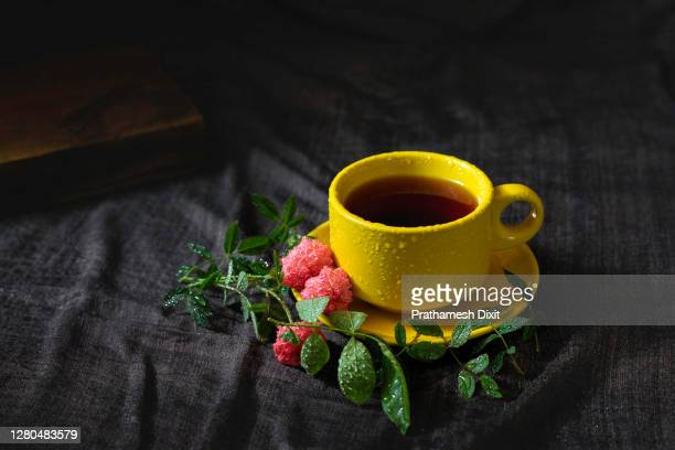 yellow cup of tea with water droplets - steeping stock pictures, royalty-free photos & images