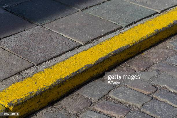 yellow curb stone border - curb stock pictures, royalty-free photos & images