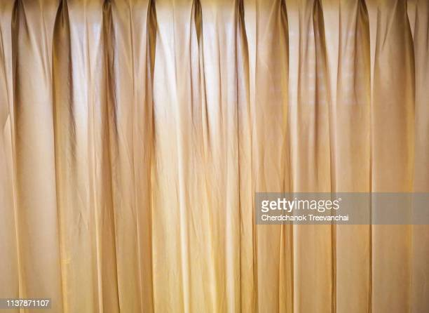 yellow curtain background - terciopelo fotografías e imágenes de stock