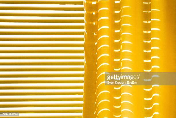 yellow curtains and yellow blinds - blinds stock pictures, royalty-free photos & images