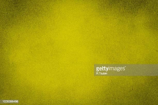 Yellow dark texture background with bright center spotlight