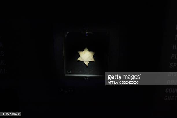 A yellow David star is on view at the Holocaust Memorial Center first central Europe's Holocaust museum in Budapest on April 16 2019 prior to the...