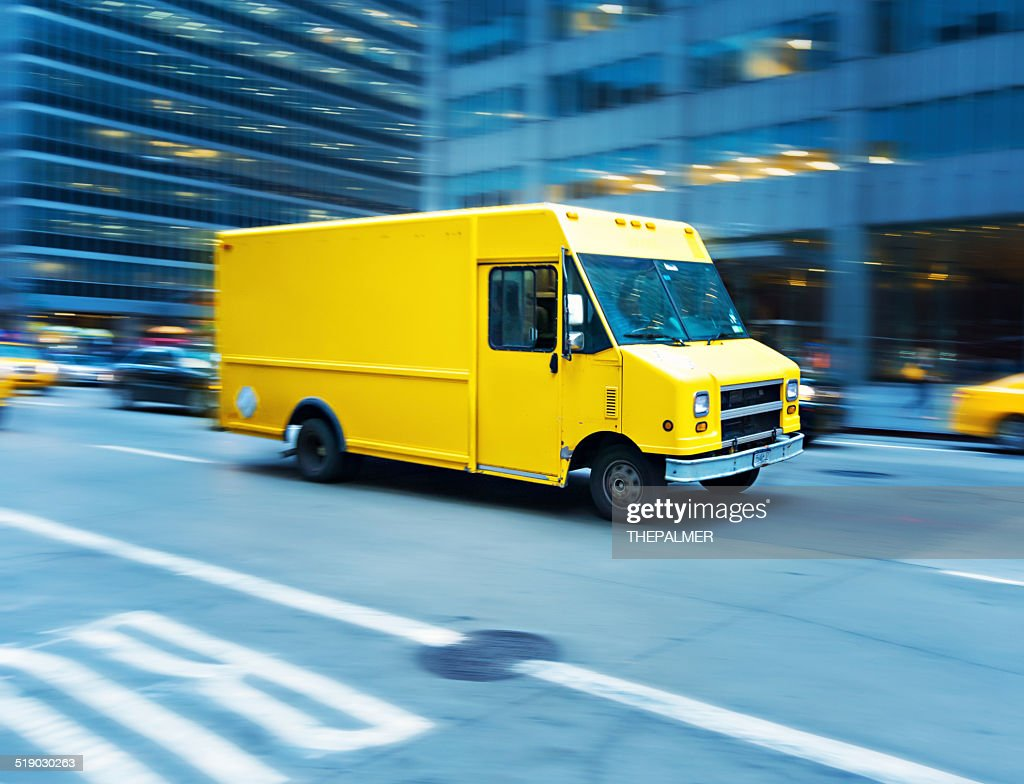 Yellow delivery truck in Manhattan : Stock Photo