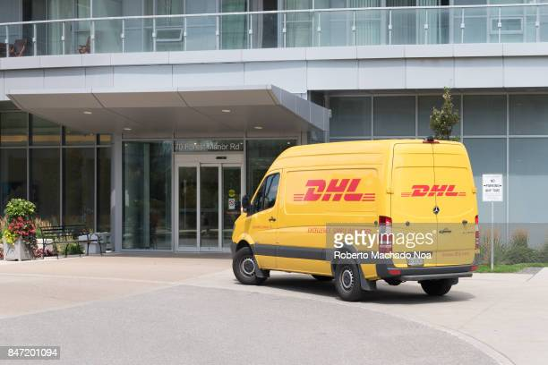 ff7e281afbbfab Yellow DHL delivery van stopping outside a gray colored commercial building