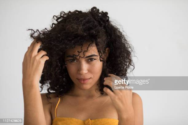 yellow dress - curly stock pictures, royalty-free photos & images