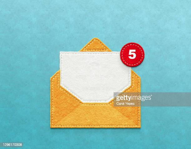 yellow envelope with notification-email concept - e mail stock-fotos und bilder