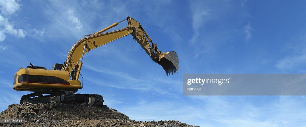 Yellow Excavator at Work : Stock Photo