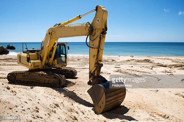 Yellow Excavator Working on Beach
