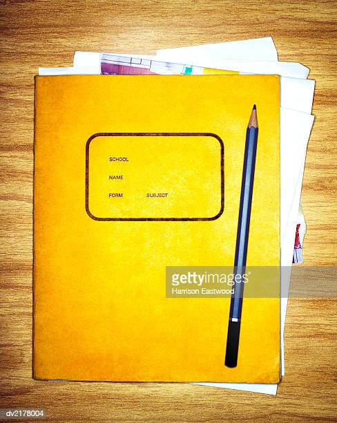 yellow exercise book and pencil - workbook stock photos and pictures
