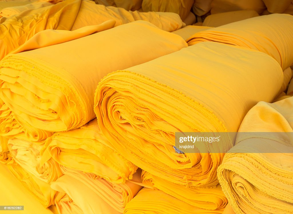 Yellow fabric roll : Foto de stock