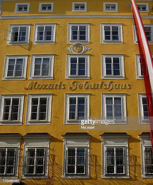 Yellow facade of Mozart's Birthplace on Getreidegasse Street in Historic Centre of Salzburg Austria