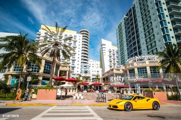yellow ferrari on south beach, miami beach, usa - miami beach stock pictures, royalty-free photos & images