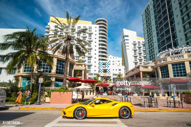 yellow ferrari on south beach, miami beach, usa - ferrari stock pictures, royalty-free photos & images