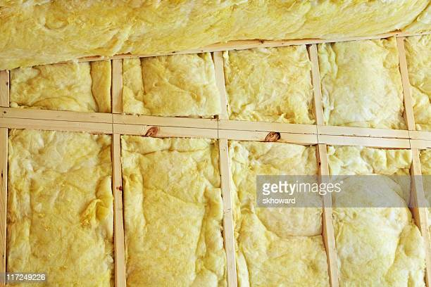 Yellow Fiberglass Insulation in Wall and Ceiling of New Construction