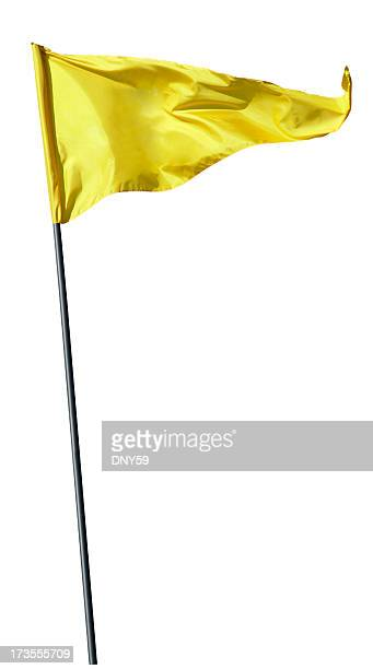 yellow flag on flag pole blowing in the wind - golf flag stock photos and pictures