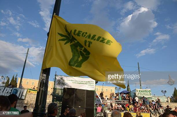 A yellow flag with the phrase 'Legalize it' People in Syntagma square gathered as part of the 1st Athens Cannabis Protestival asking for the...