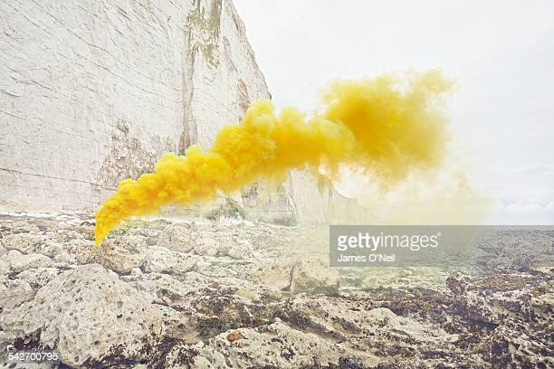 yellow flare on beach with chalk cliff - yellow stock pictures, royalty-free photos & images