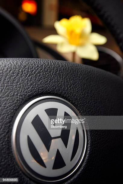 A yellow flower sits in the vase that comes standard on the dashboard of the New VW Beetle automobile at a Volkswagen AG auto dealership in Berlin...