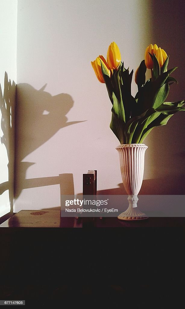 Yellow Flowers In Vase On Table At Home Stock Photo Getty Images