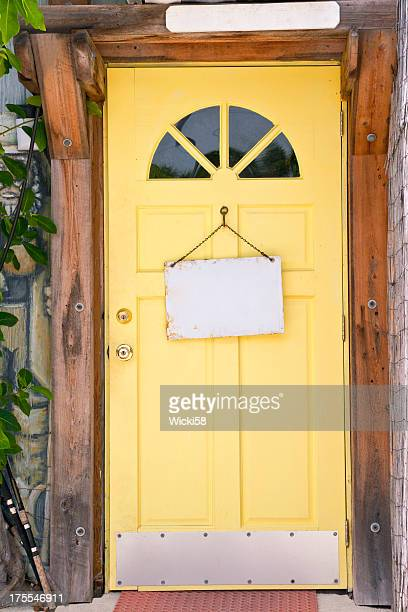 Yellow Front Door with blank Signs