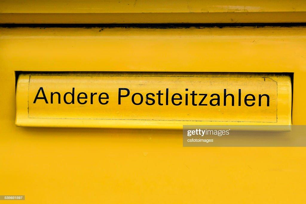 Yellow German Mail Box : Stock Photo