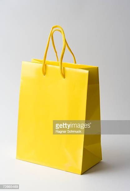 yellow gift bag - shopping bag stock pictures, royalty-free photos & images