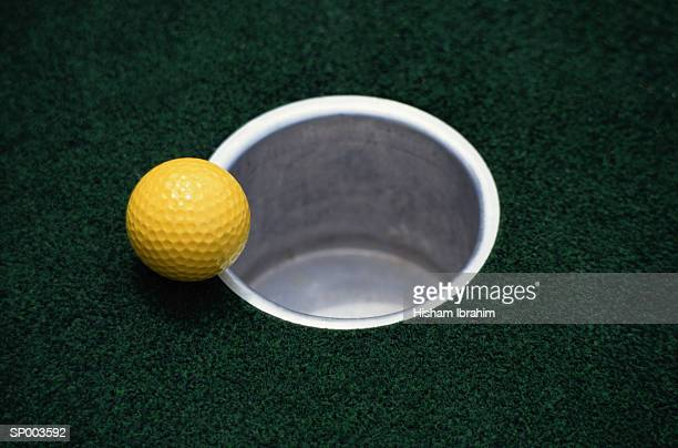 Yellow Golf Ball and Hole