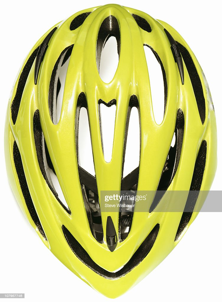 A yellow green cycling helmet : Stock Photo