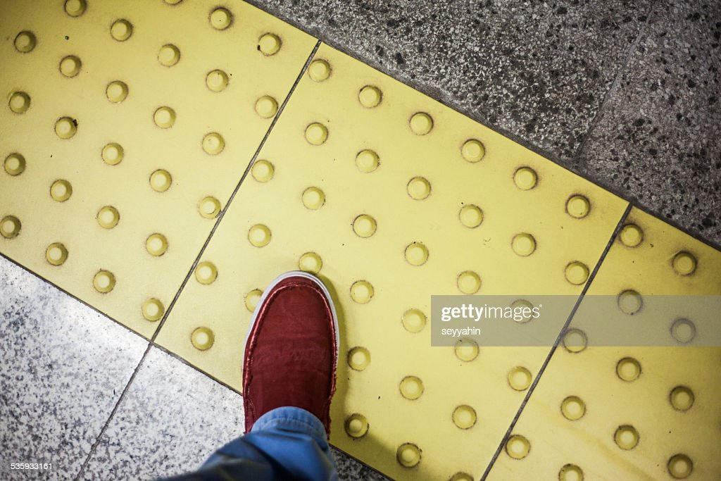 yellow ground with red shoe : Stock Photo