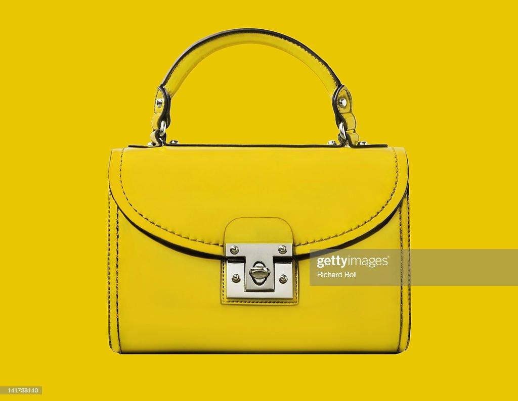 A yellow handbag against a yellow background : ストックフォト