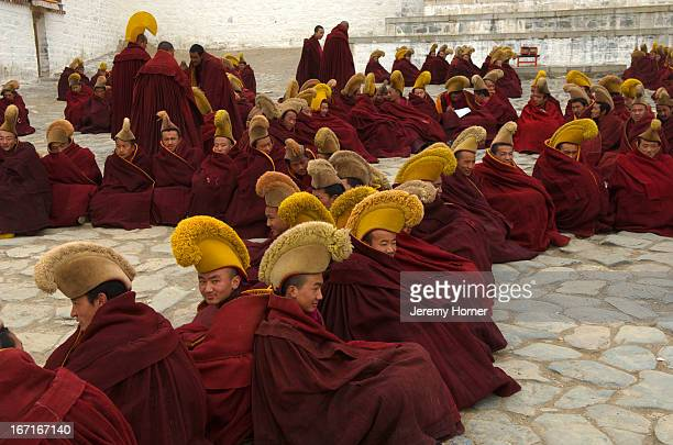 Yellow Hat Buddhist monks at prayer Labrang Monastery during Tibetan New Year celebrations Gansu Province China Labrang Monastery is one of six...