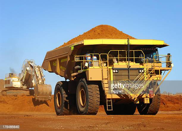 Yellow haul truck loaded with dirt and ore