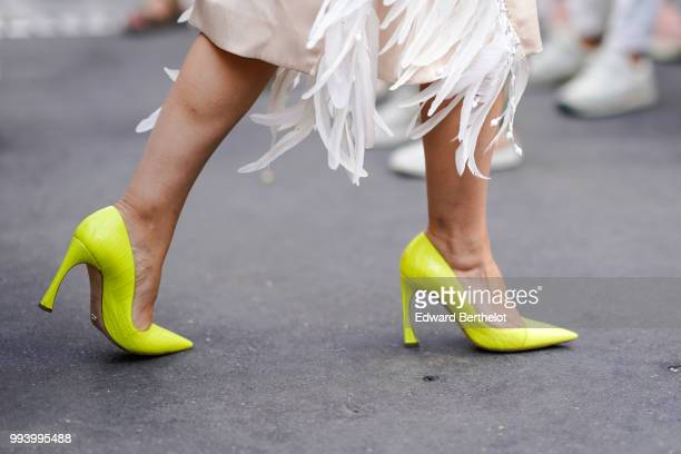 Yellow heels shoes , outside Fendi, during Paris Fashion Week Haute Couture Fall Winter 2018/2019, on July 4, 2018 in Paris, France.