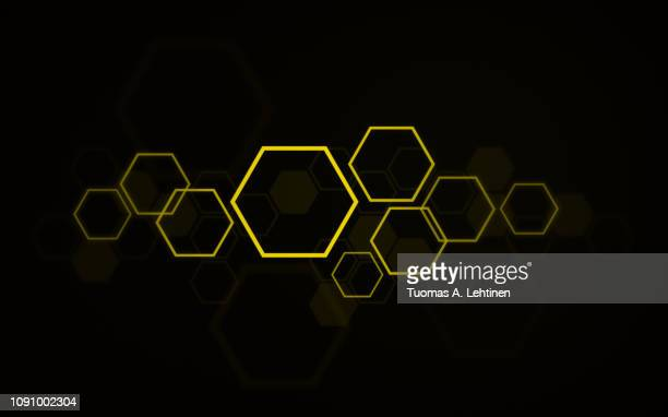 Yellow hexagons on black background