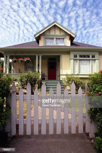Yellow Home Behind Picket Fence