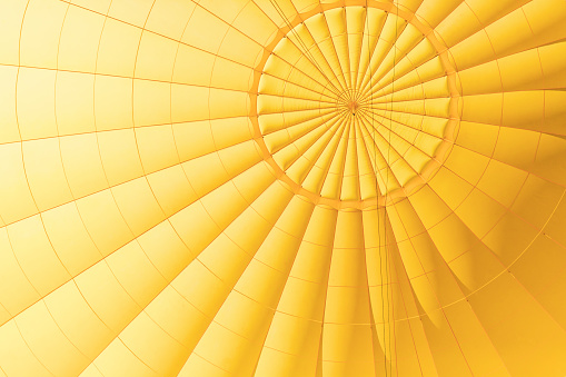 Yellow hot air balloon. Close-up of the yellow envelope. - gettyimageskorea