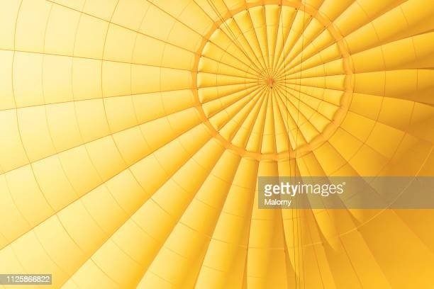 yellow hot air balloon. close-up of the yellow envelope. - gelb stock-fotos und bilder