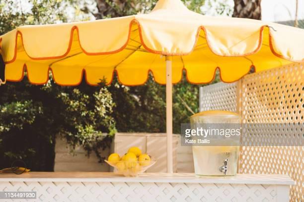 yellow hotel beach umbrella and water cooler, palm springs, california, usa - セルフサービス ストックフォトと画像