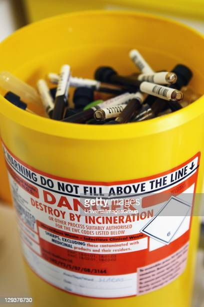 Yellow incineration bucket used for disposal of medical waste