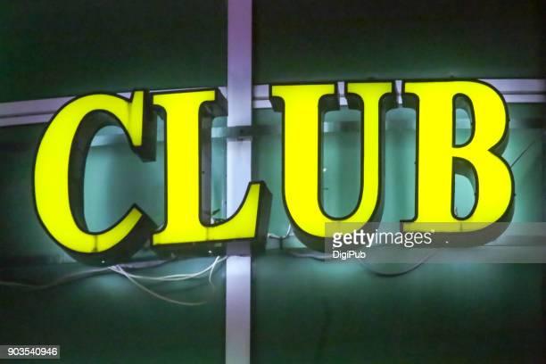 "Yellow internally illuminated sign ""CLUB"""