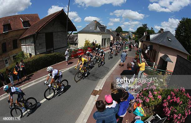 Yellow jeresey wearer Tony Martin of Germany and EtixxQuick Step rides with the peloton as they are cheered on by spectators during stage six of the...