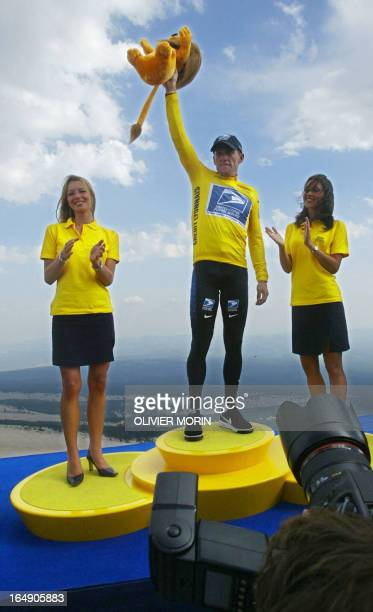 Yellow jersey and leader of the US Postal Service team US Lance Armstrong celebrates on the podium of the 14th stage of the 89th Tour de France in...