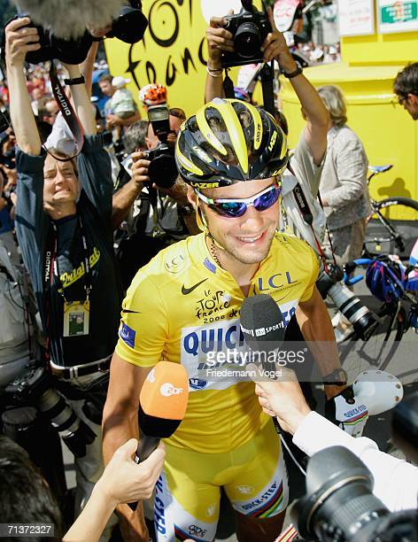 Yellow jersey cyclist Tom Boonen of Belgium and Quick Step answers journalists' questions before Stage 4 of the 93rd Tour de France between Huy and...