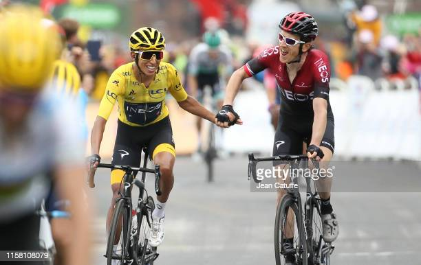 Yellow jersey Egan Bernal Gomez of Colombia and Team Ineos is congratulated by teammate and title holder Geraint Thomas of Great Britain and Team...