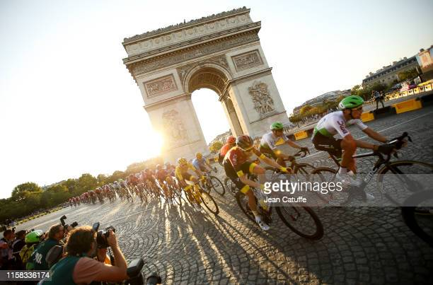 Yellow jersey Egan Bernal Gomez of Colombia and Team Ineos passes with the pack in front of Arch of Triumph at the top of Avenue des Champs Elysees...