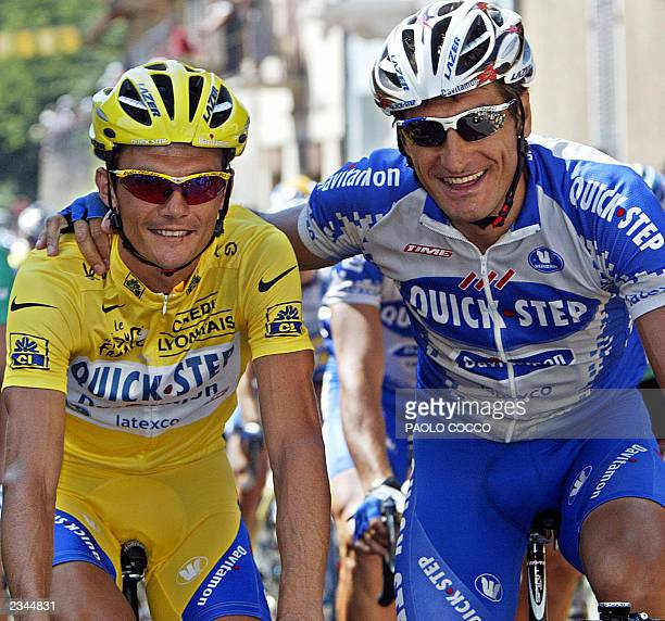 yellow jersey Frenchman Richard Virenque poses with his teammate Hungarian Laszlo Bodrogi before the eighth stage of the 90th Tour de France cycling...
