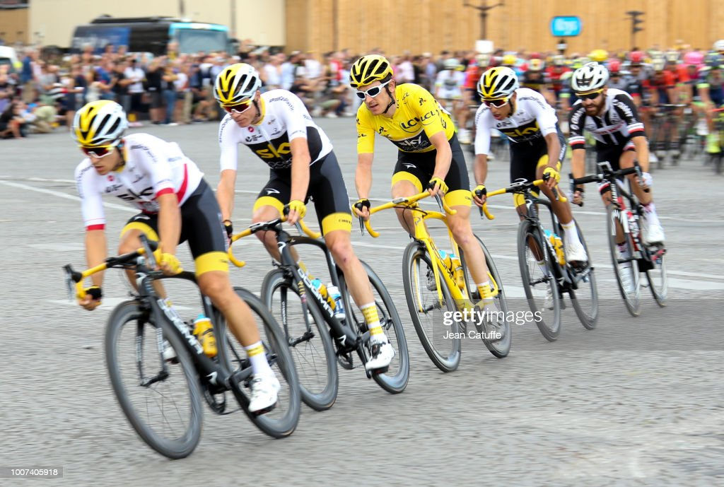 Yellow jersey Geraint Thomas of Great Britain and Team Sky surrounded by Michal Kwiatkowski of Poland and Team Sky, Chris Froome of Great Britain and Team Sky and Egan Bernal Gomez of Colombia and Team Sky during stage 21 of Le Tour de France 2018 between Houilles and Paris - avenue des Champs-Elysees (116 km) on July 29, 2018 in Paris, France.