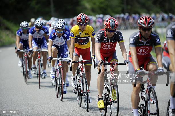 Yellow jersey Janez Brajkovic rides with his teammates during the Dauphine Criterium cycling race's fourth stage on June 10, 2010 between Risoul and...
