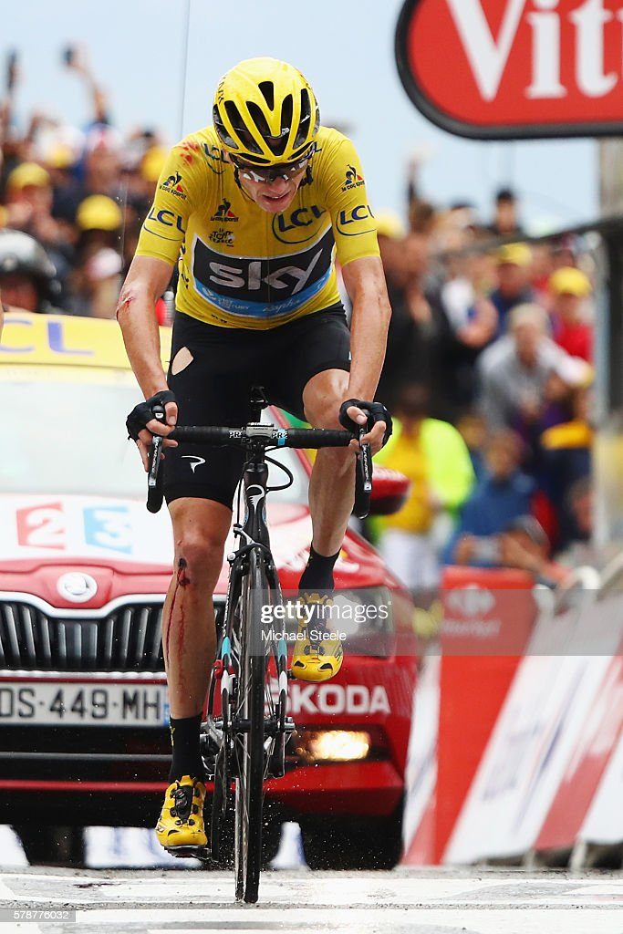 Yellow Jersey leader Chris Froome of Great Britain and Team Sky crosses the finish line with cuts, ripped clothing and riding the bike of team mate Geraint Thomas after falling in wet conditions and breaking his own bike during the 146 km mountain stage nineteen of Le Tour de France from Albertville to Saint-Gervais Mont Blanc on July 22, 2016 in Saint-Gervais Mont Blanc, France.