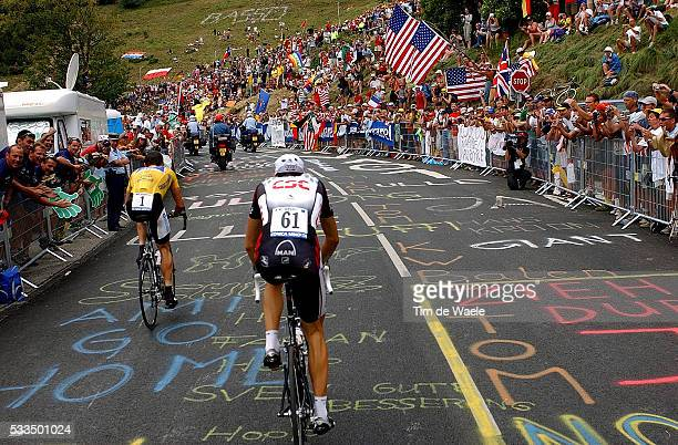 Yellow jersey leader Lance Armstrong and Ivan Basso ride the 155 kilometres of the stage 16 mountain time trial from Bourg d'Oisans to L'Alpe d'Huez...